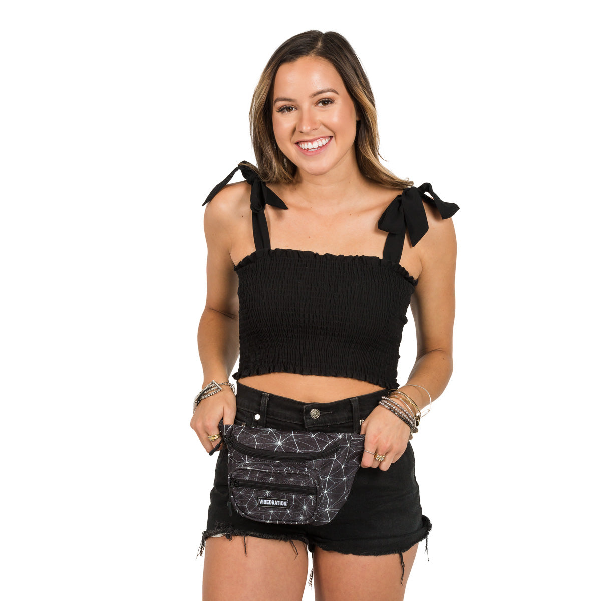 female wearing black space waist pack with three storage pockets