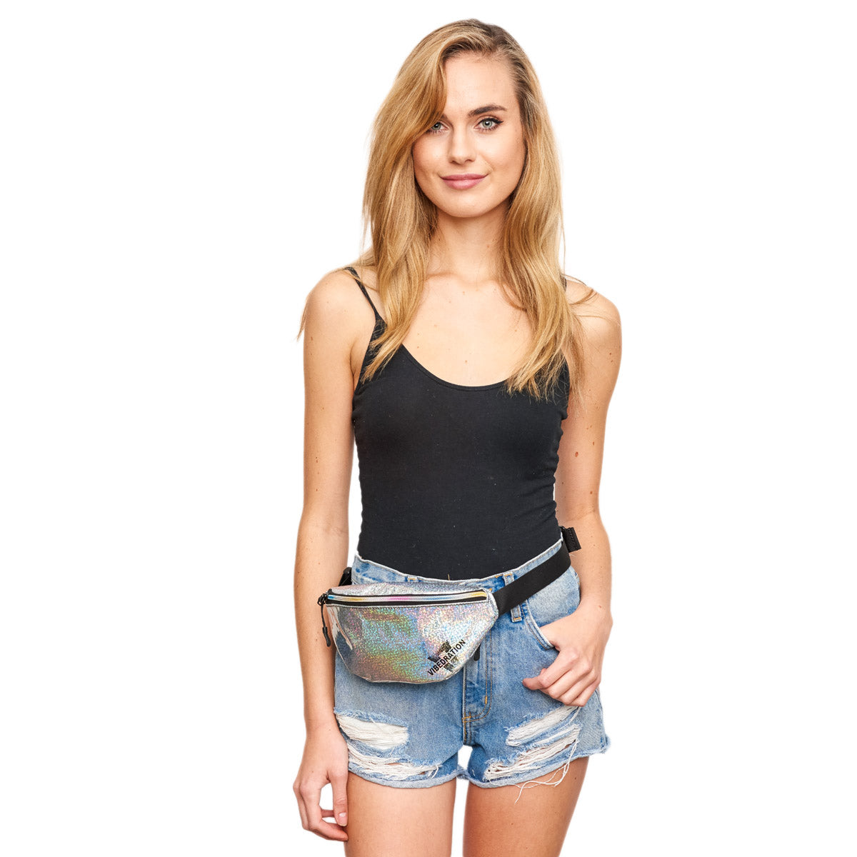 Girl wearing holographic silver fanny pack for music festivals