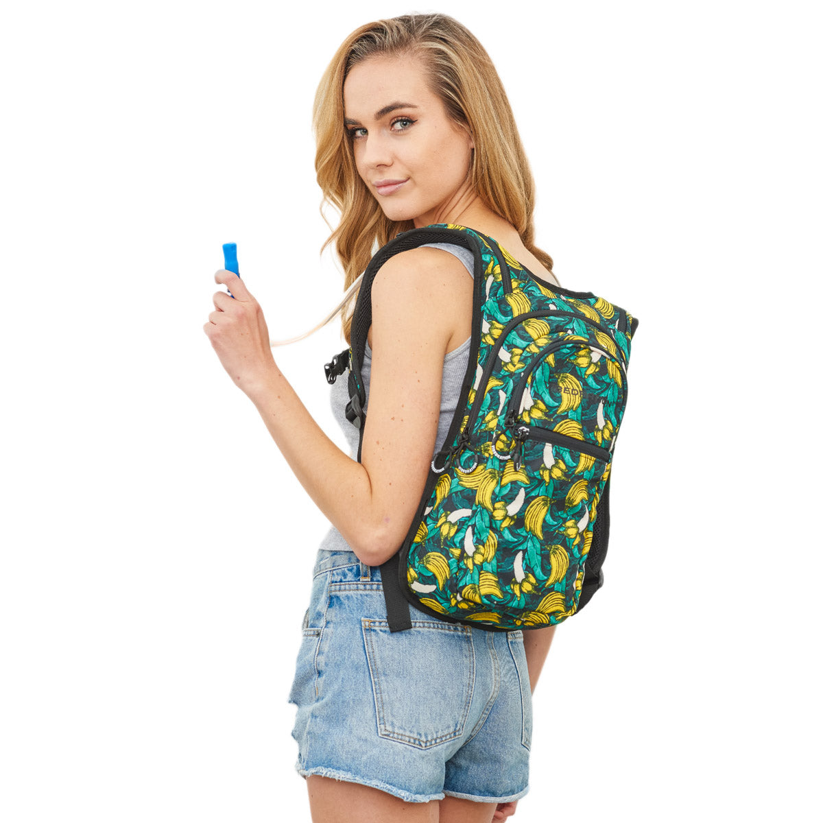 Female wearing Green Tropical Banana Print Hydration Backpack