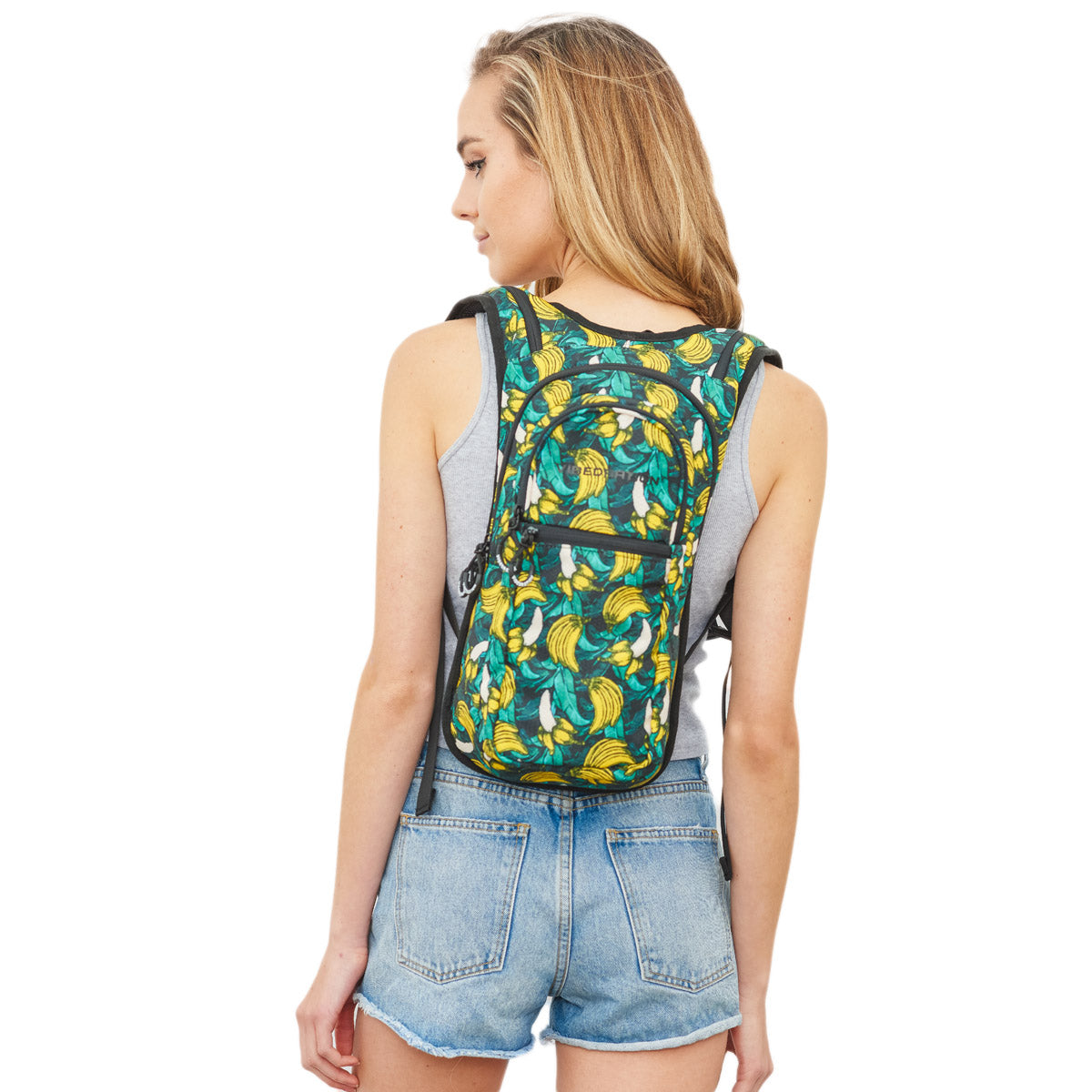 Back view of female wearing Green Tropical Banana Print Hydration Backpack