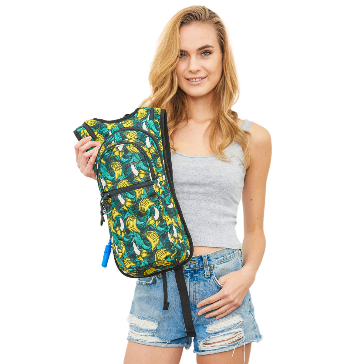 Female holding Green Tropical Banana Print Hydration Backpack