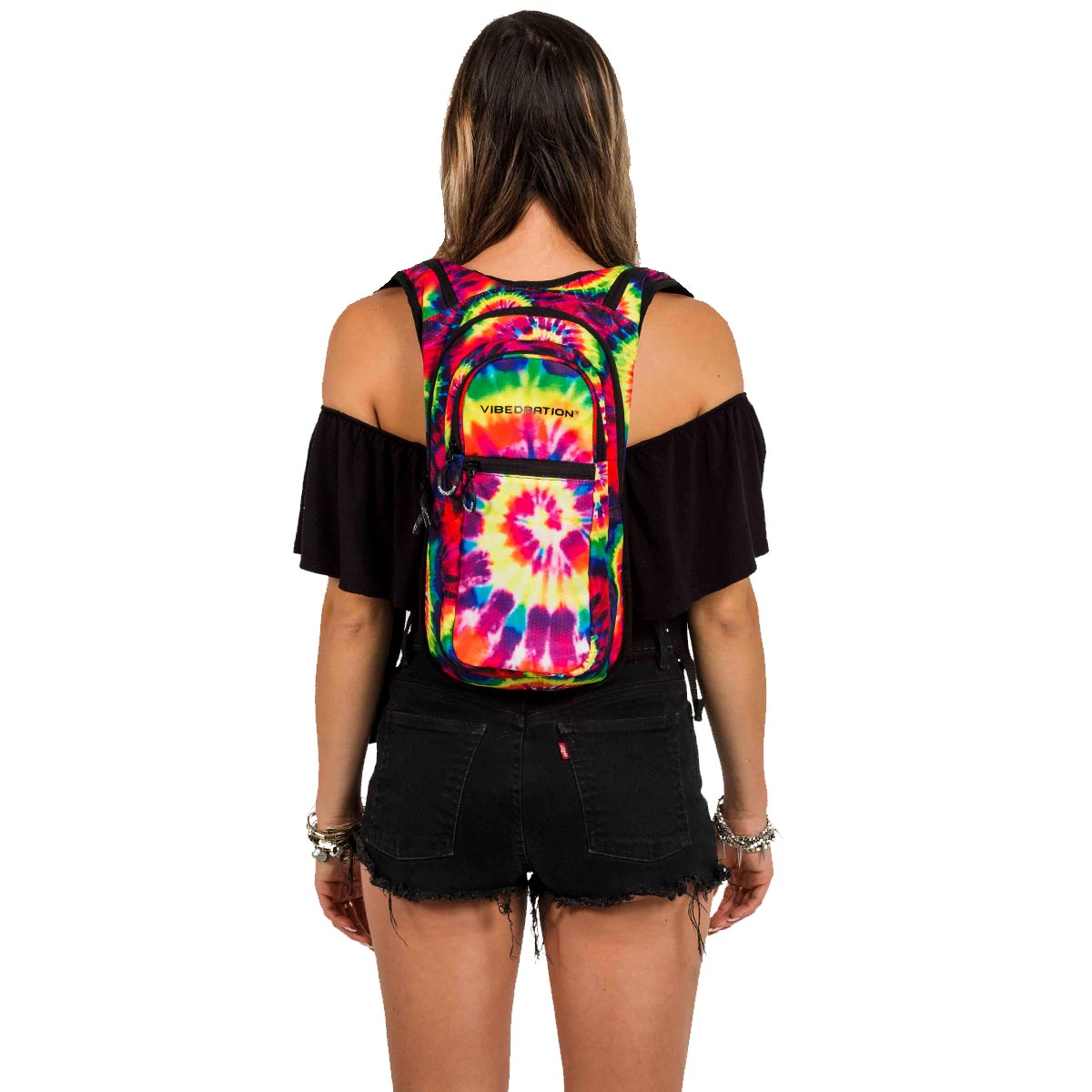 Back view of female wearing tie dye backpack with hydration pack