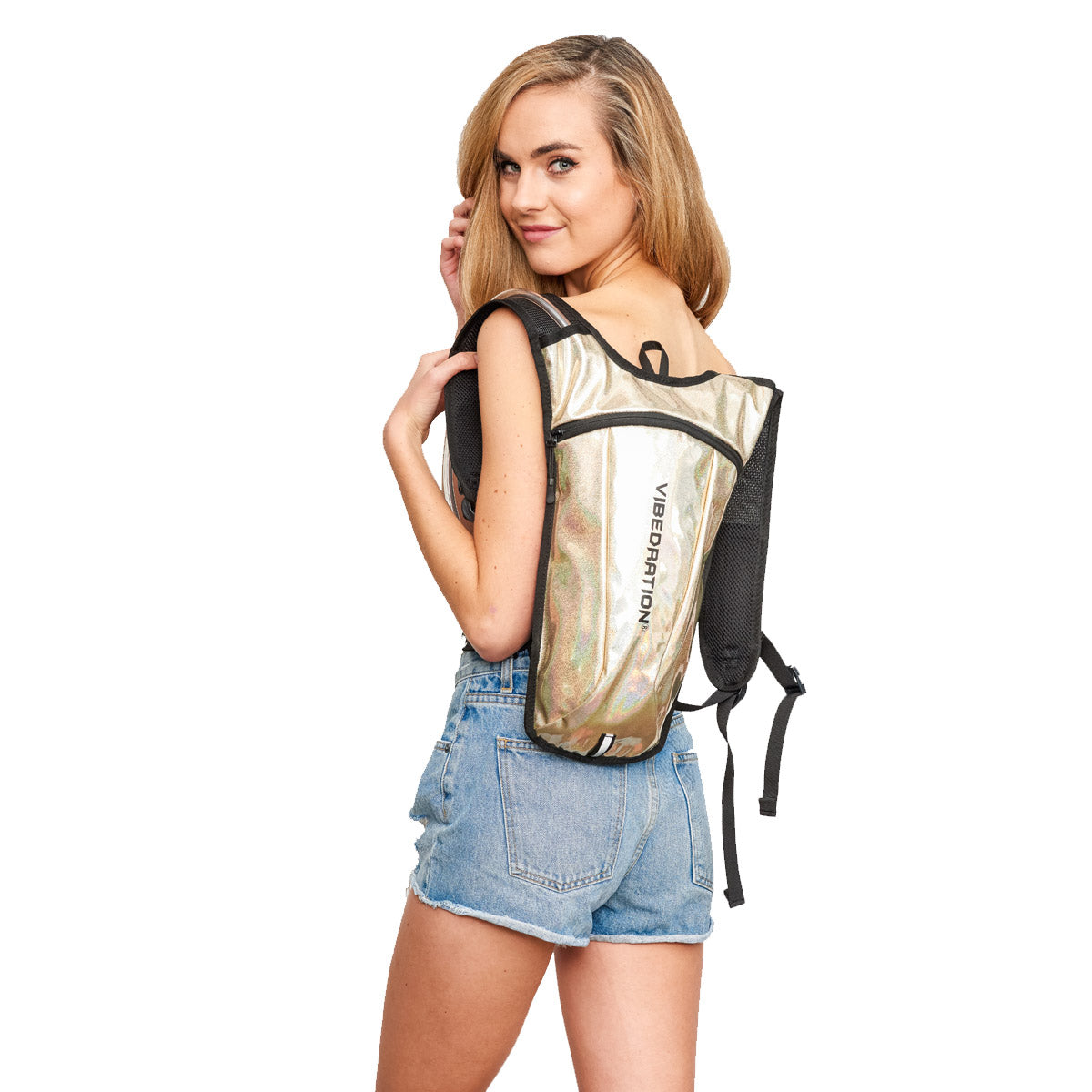 girl wearing champagne luxe hydration pack for raves and music festivals