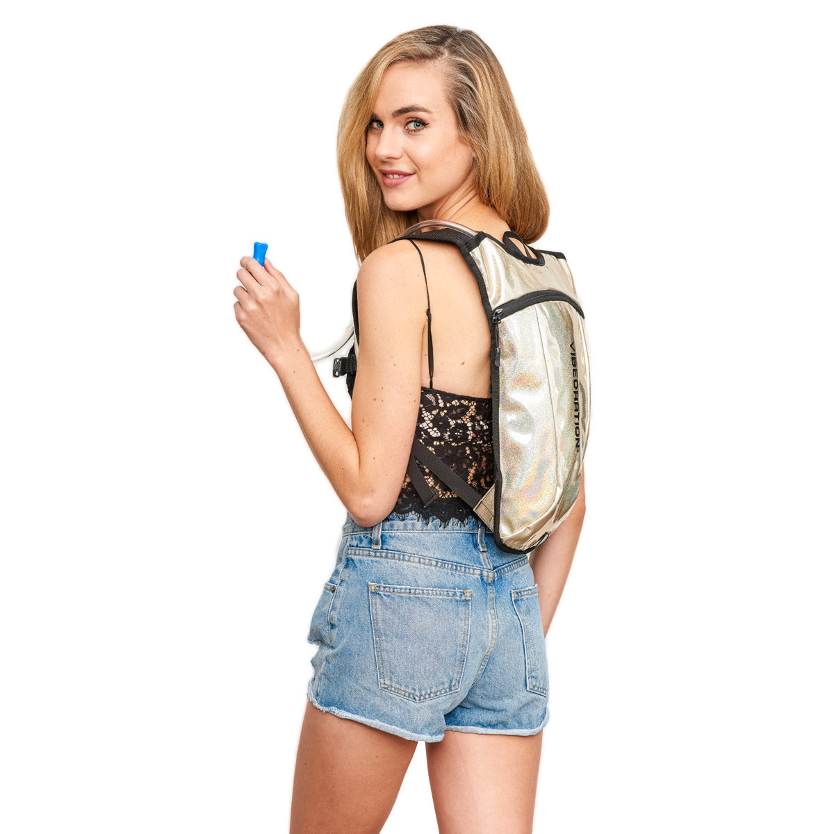 girl wearing champagne holographic hydration pack for raves