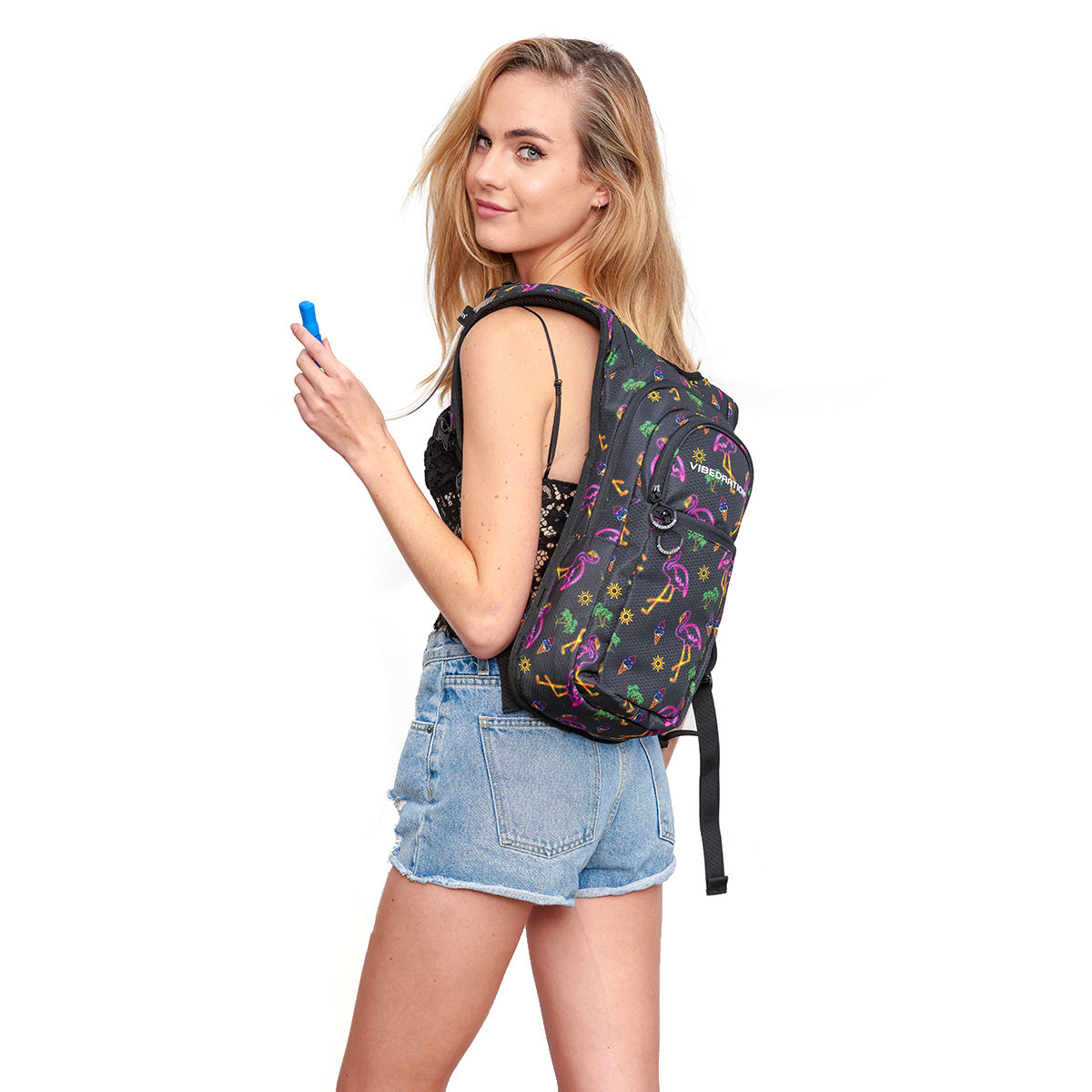 Woman wearing Neon Flamingo Printed VIP 2.0L EDC Hydration Pack - Side Shot