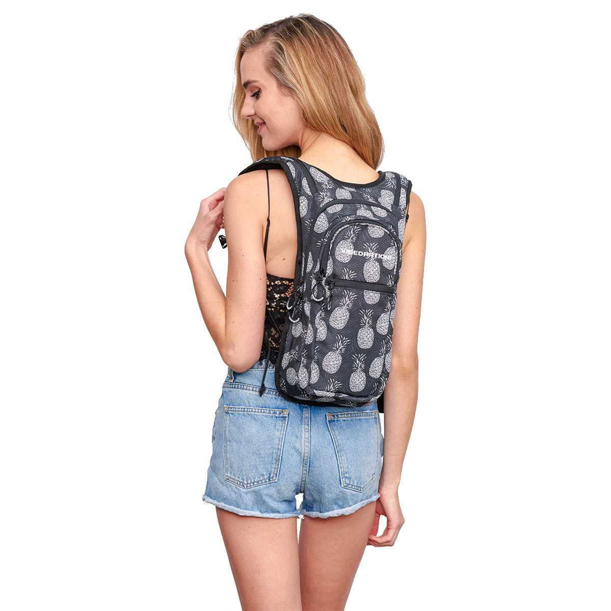 Back shot of woman wearing Black Pineapples Festival Hydration Pack