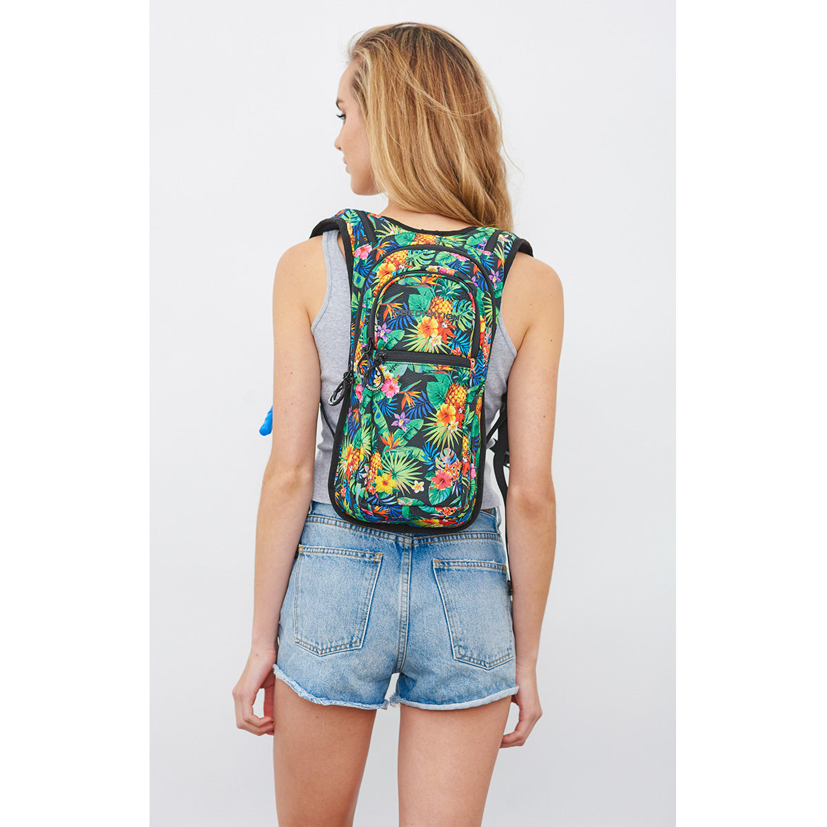 Back shot of Woman wearing VIP Tropical Printed Festival Hydration Pack