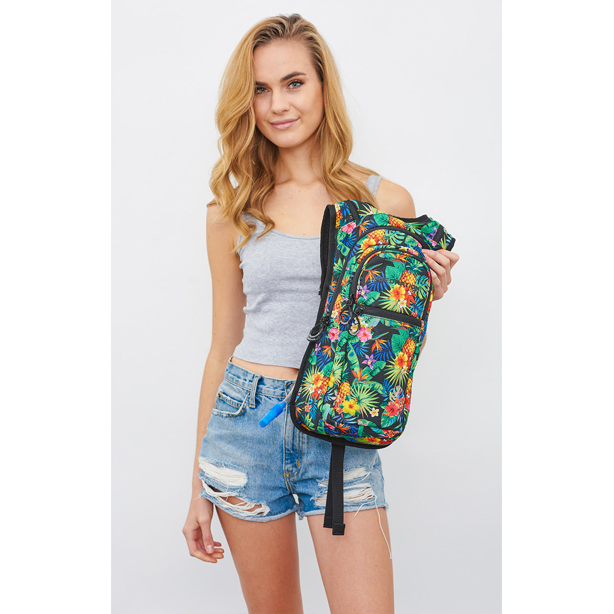 Women Holding VIP Tropical Fuzion Festival Hydration Pack