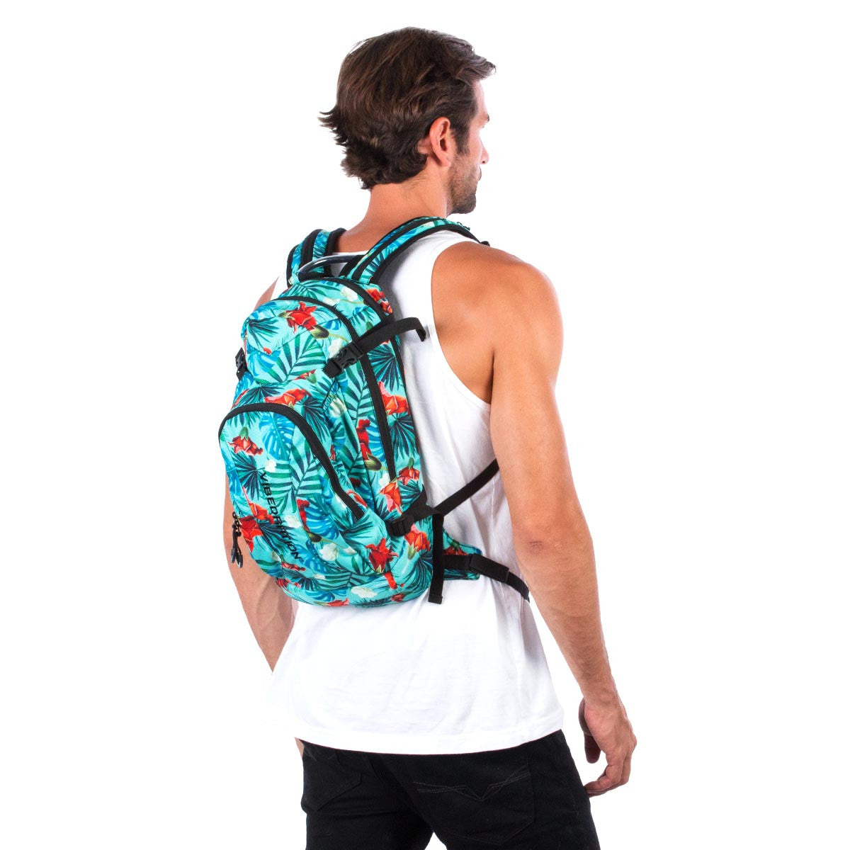 Side view of male wearing aqua blue Hawaiian water backpack.