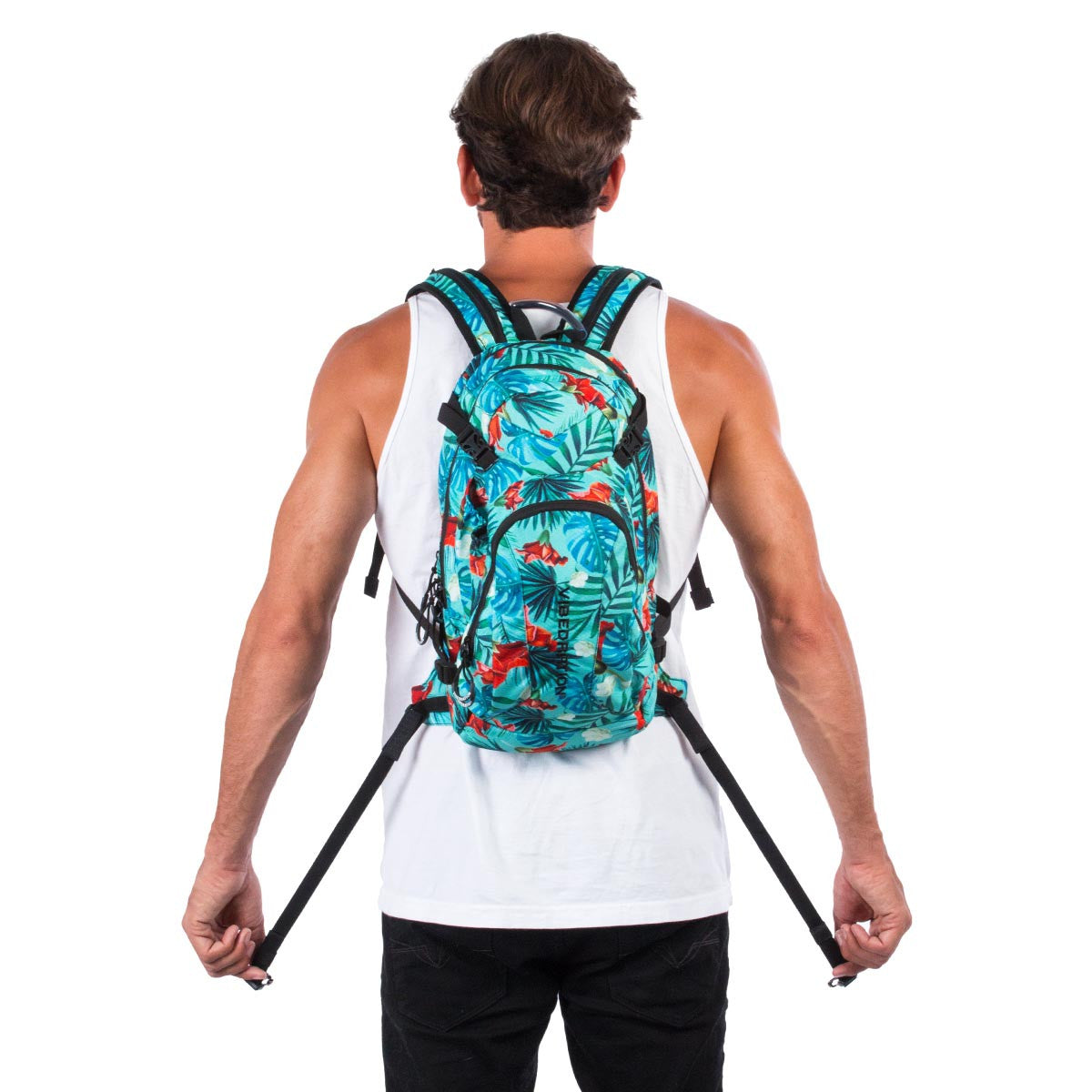 Back view of male wearing aqua blue Hawaiian water backpack.
