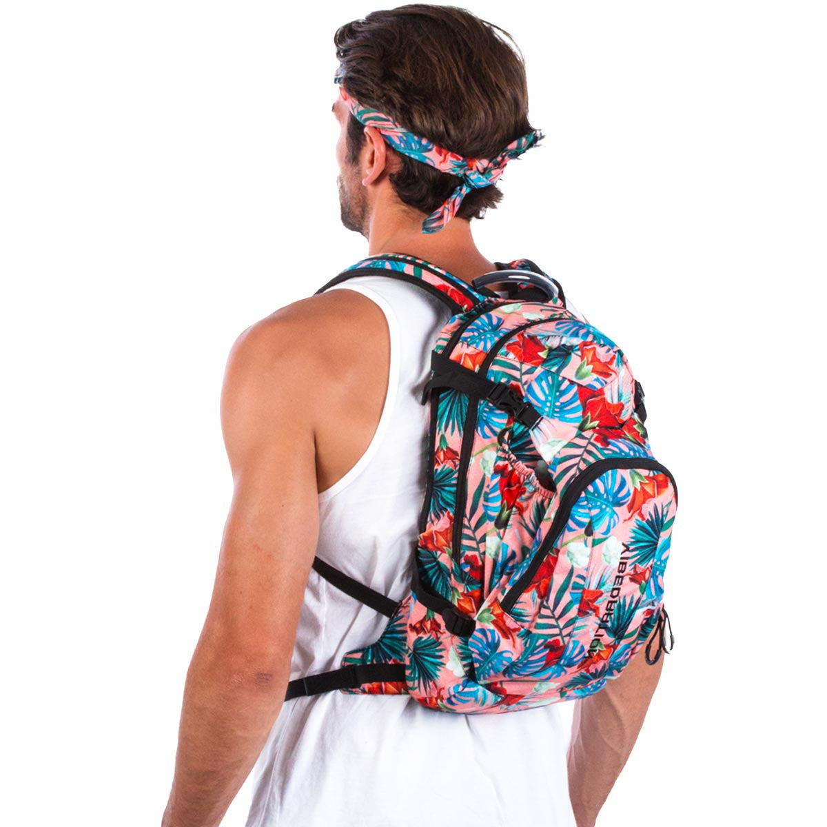 Side view of male wearing coral Hawaiian water backpack.