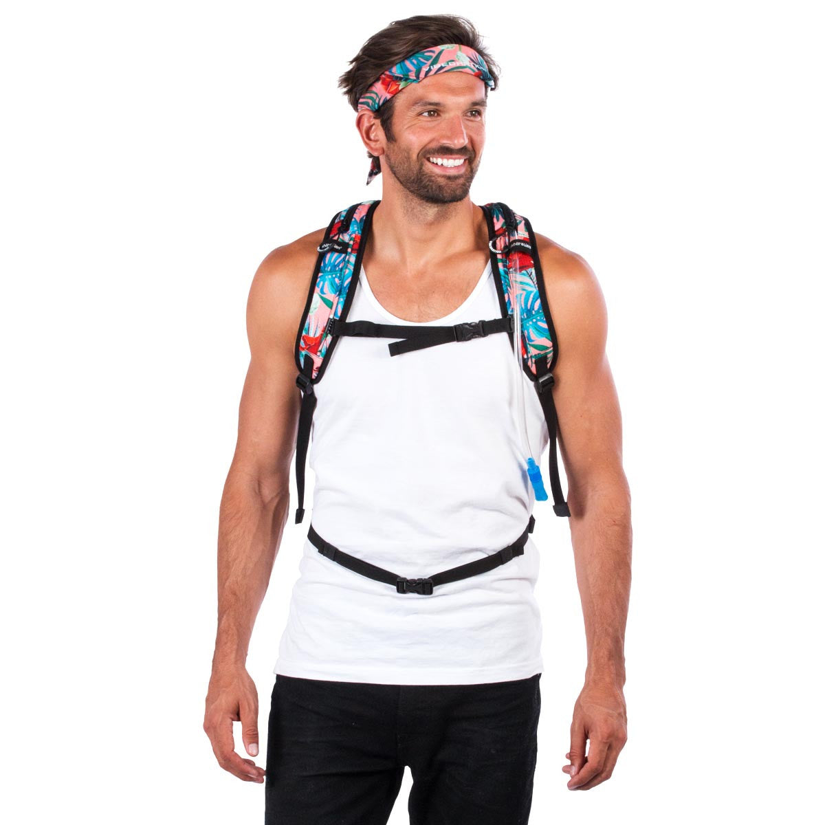 Front view of male wearing coral Hawaiian water backpack.