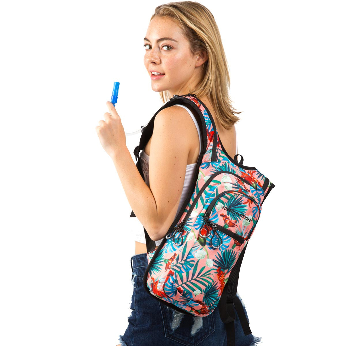 Side view of female wearing coral printed Hawaiian water pack