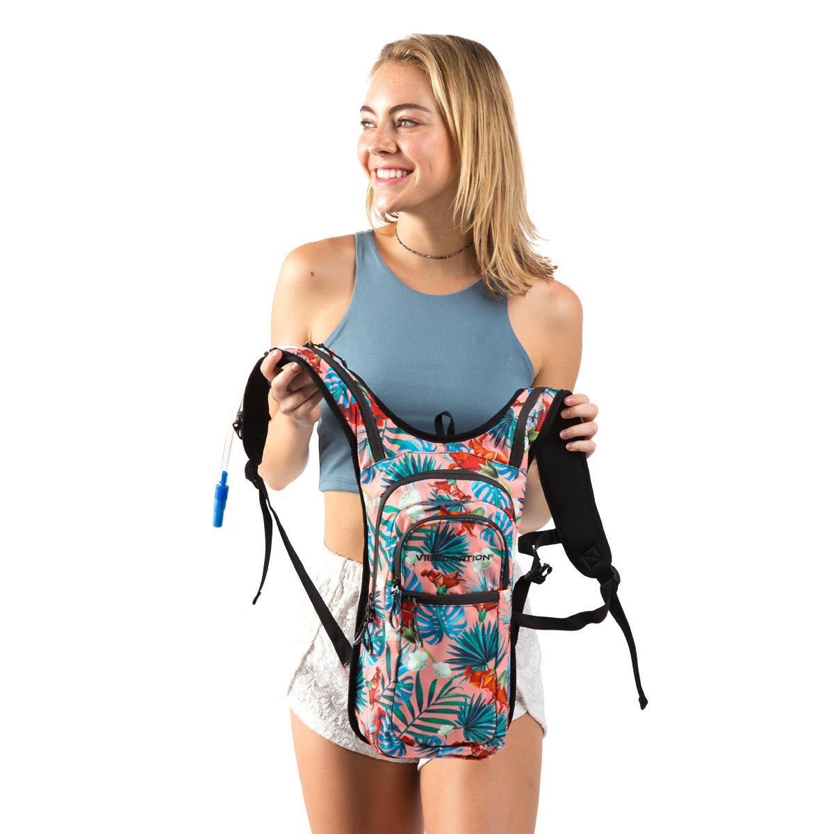 Female holding coral printed Hawaiian water pack