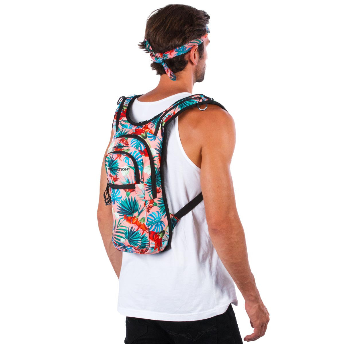 Side view of male wearing coral printed Hawaiian water pack