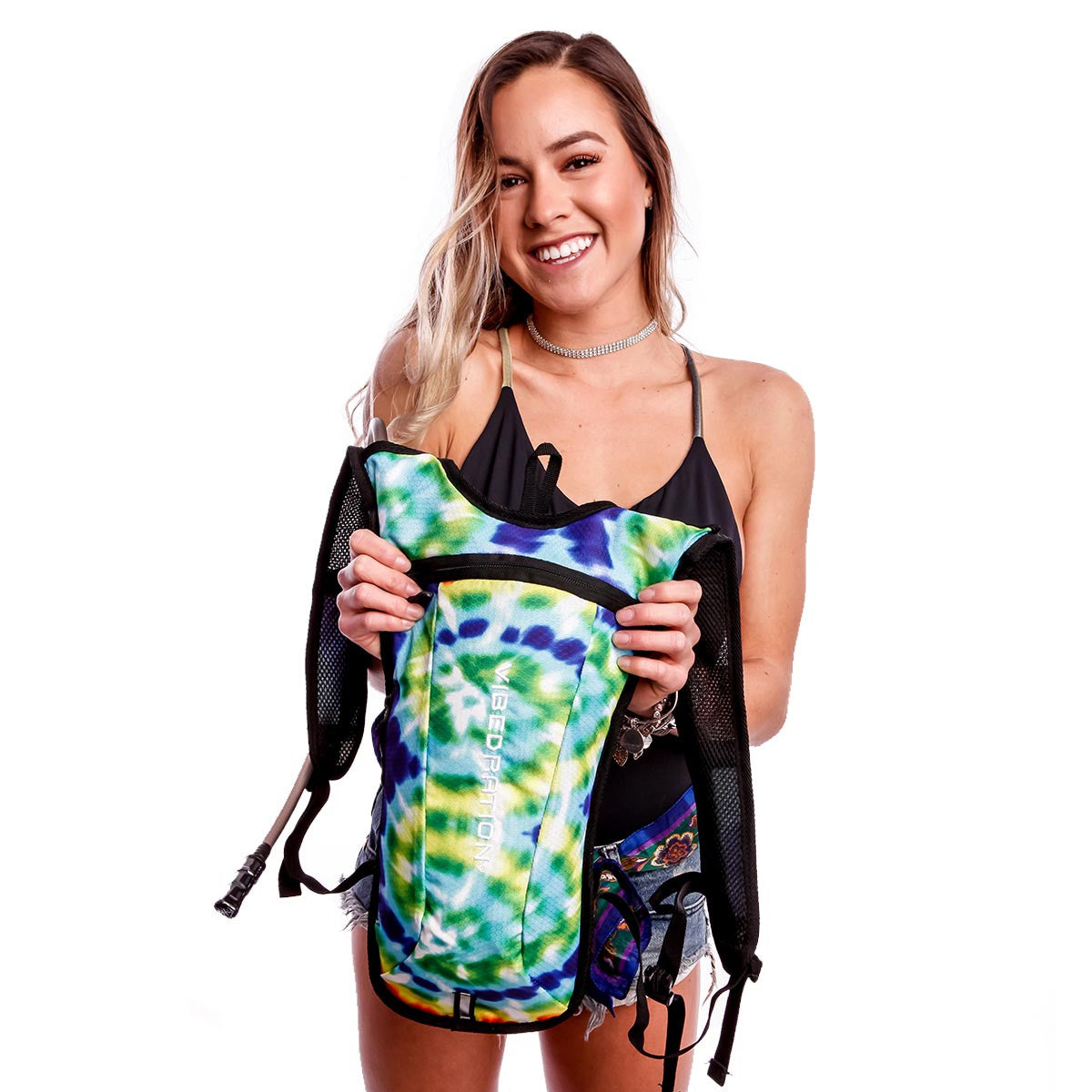 Female holding Tie Dye hydration pack