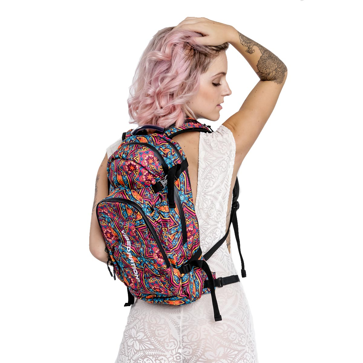 Female wearing cute bohemian hydration backpack with 3L water reservoir and three storage pockets.