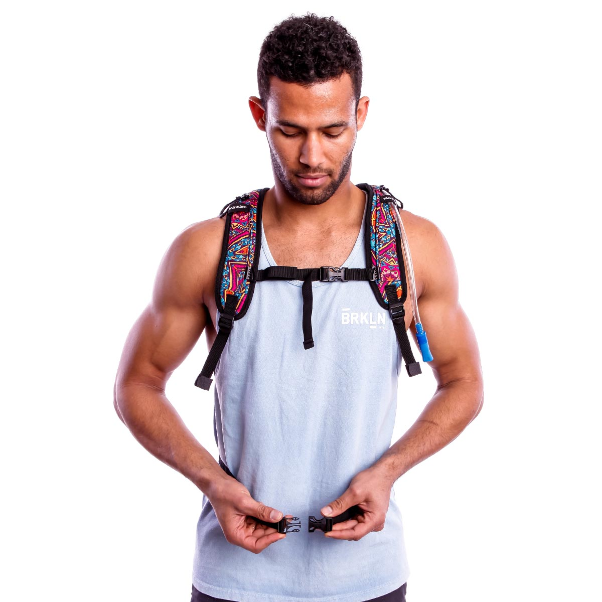 Male wearing bohemian printed large Hydration Pack with adjustable chest and waist strap.