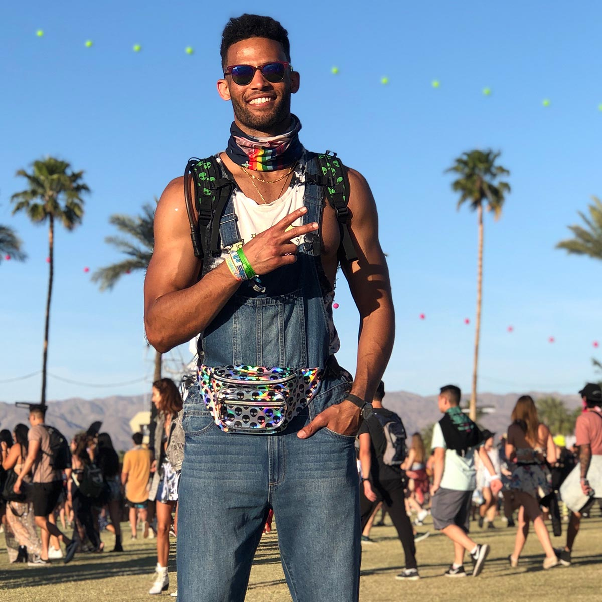 Male wearing Alien holograhpic waist pack
