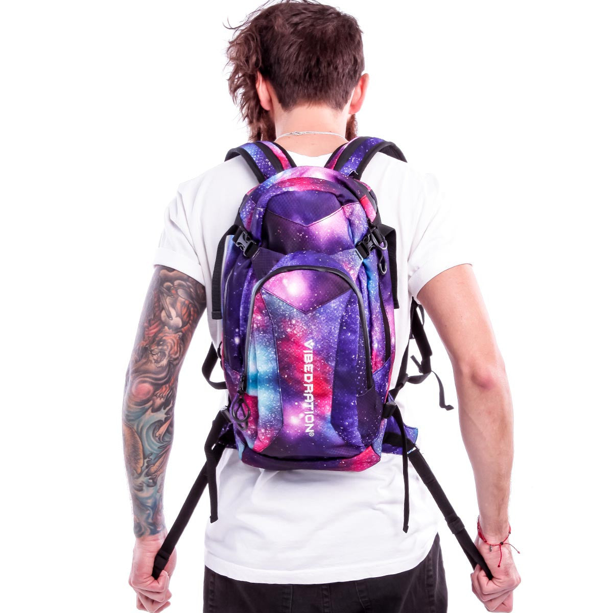 Male wearing large Galaxy hydration pack