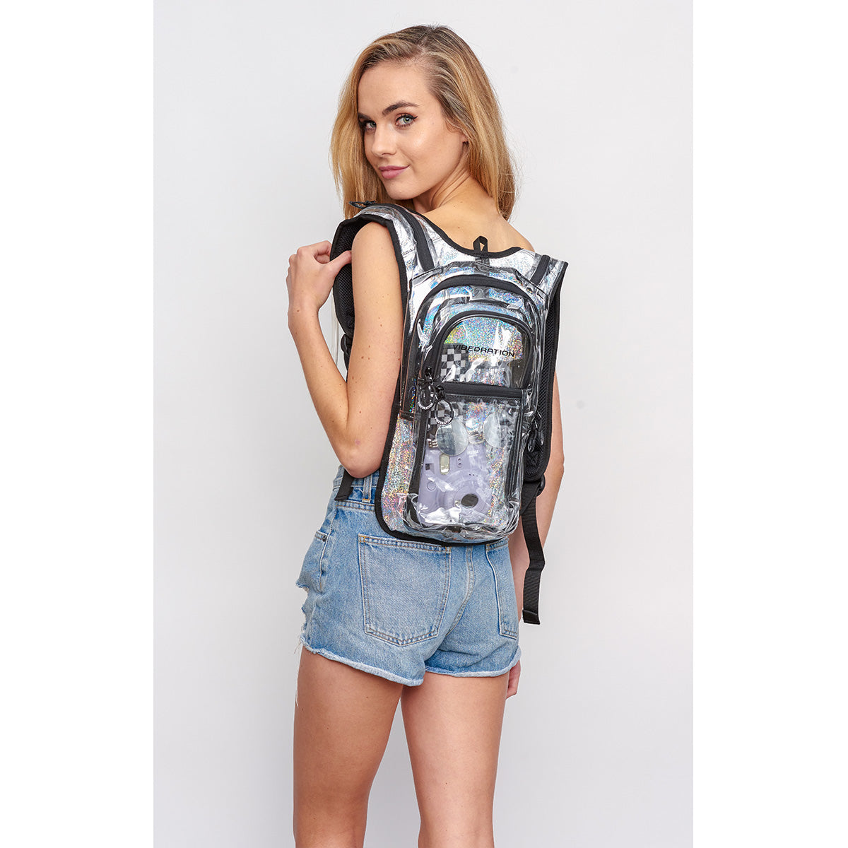 Women side shot wearing VIP 2.0L Silver Sparkles Clear EDC Hydration Pack
