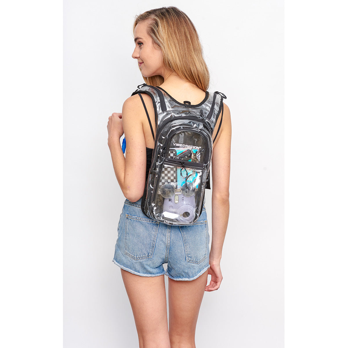 Back shot of Woman wearing Crystal Clear VIP Festival Hydration Pack