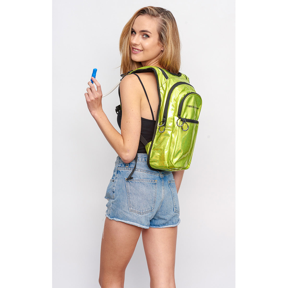 Women Side shot wearing Neon Yellow VIP Festival Hydration Pack