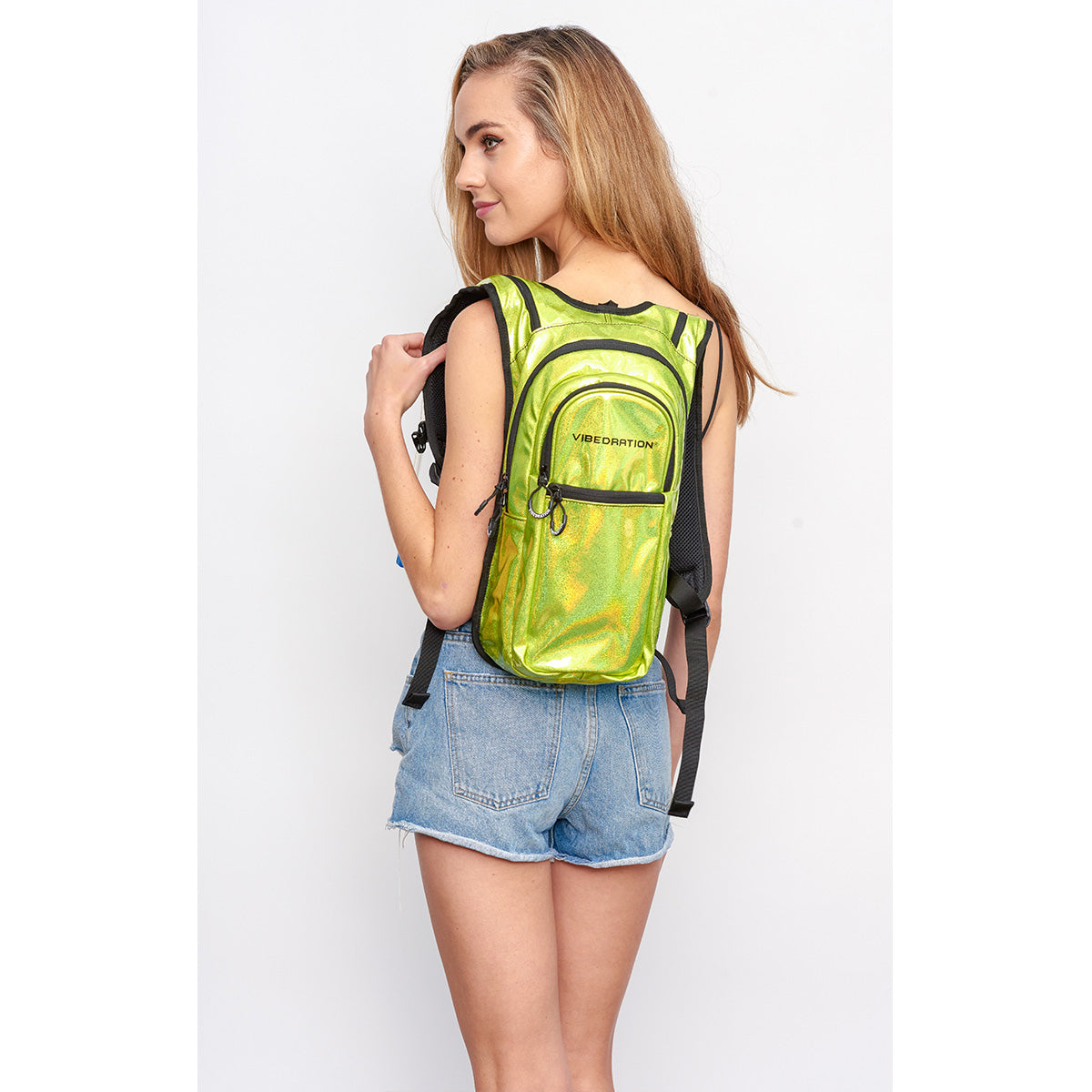Back shot of Women Wearing VIP Holla-Graphic Neon EDC Hydration Pack