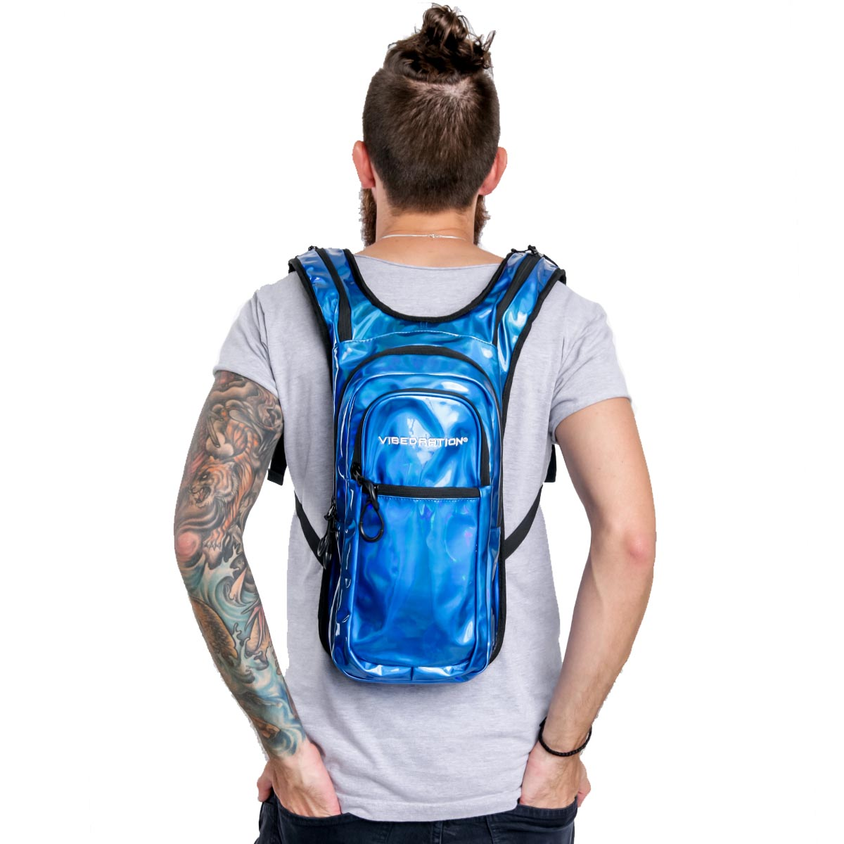 Male wearing blue holographic hydration pack with 2L water capacity.
