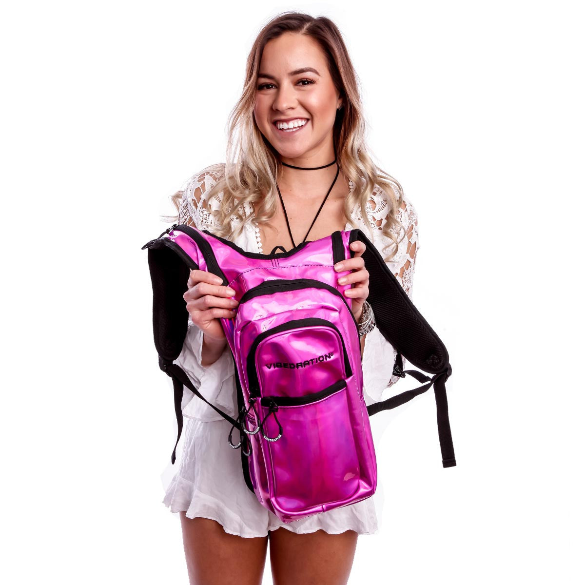 Female holding Pink holographic hydration pack