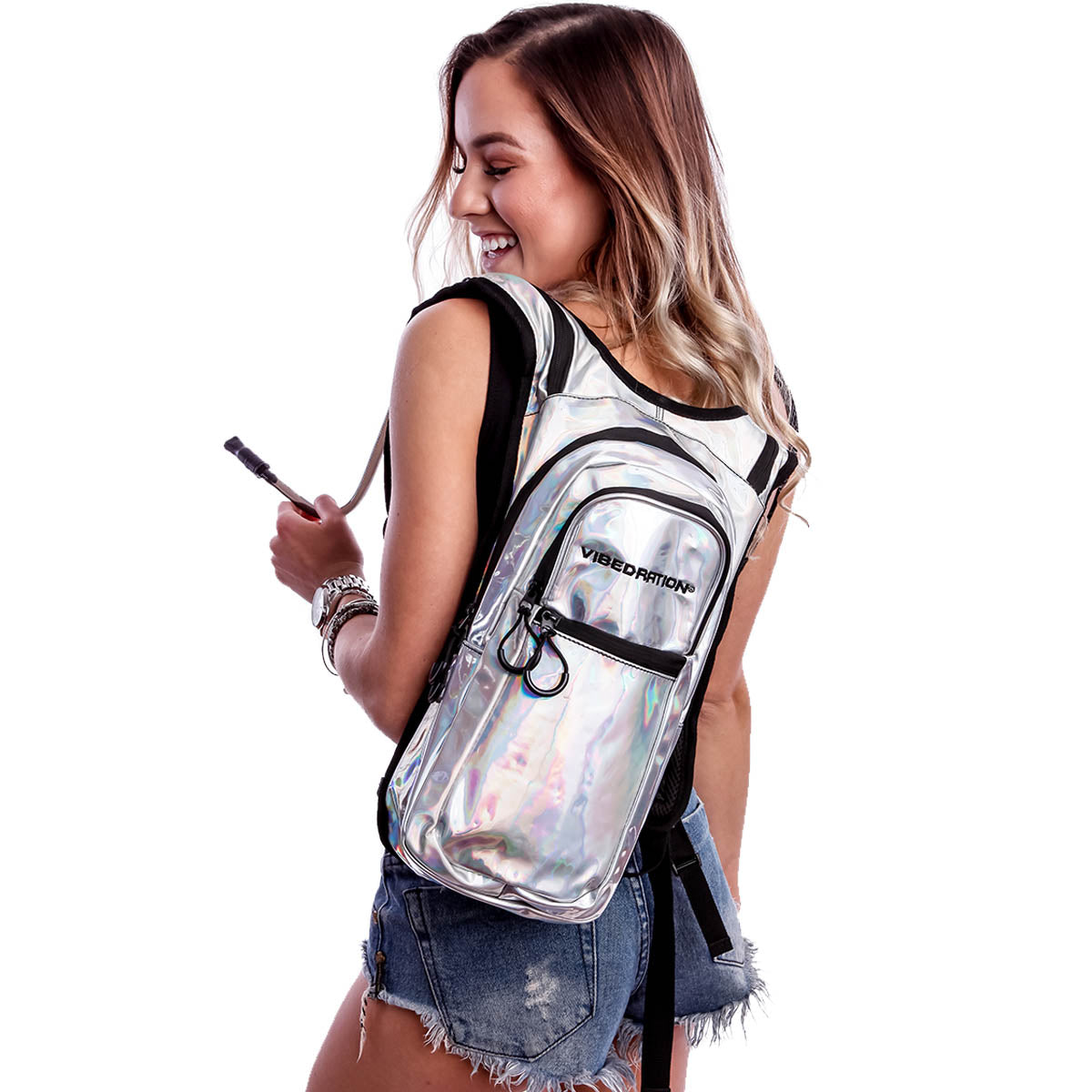 Female wearing silver holographic hydration pack.