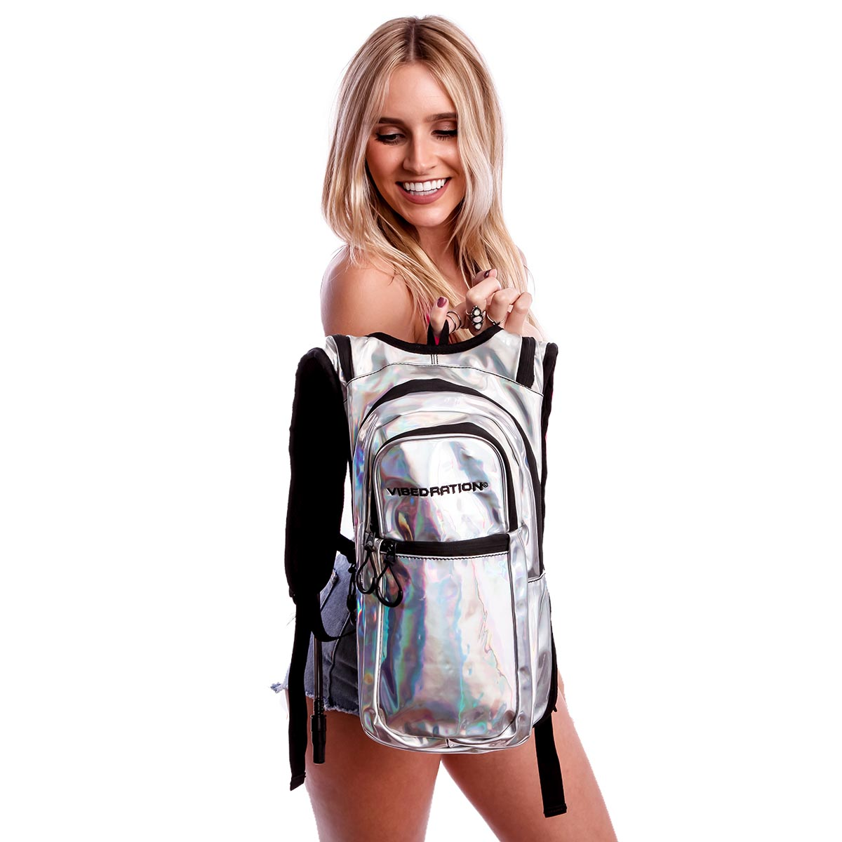 Female holding silver holographic hydration pack