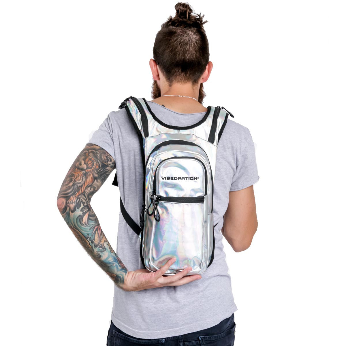 Male wearing silver hydration pack