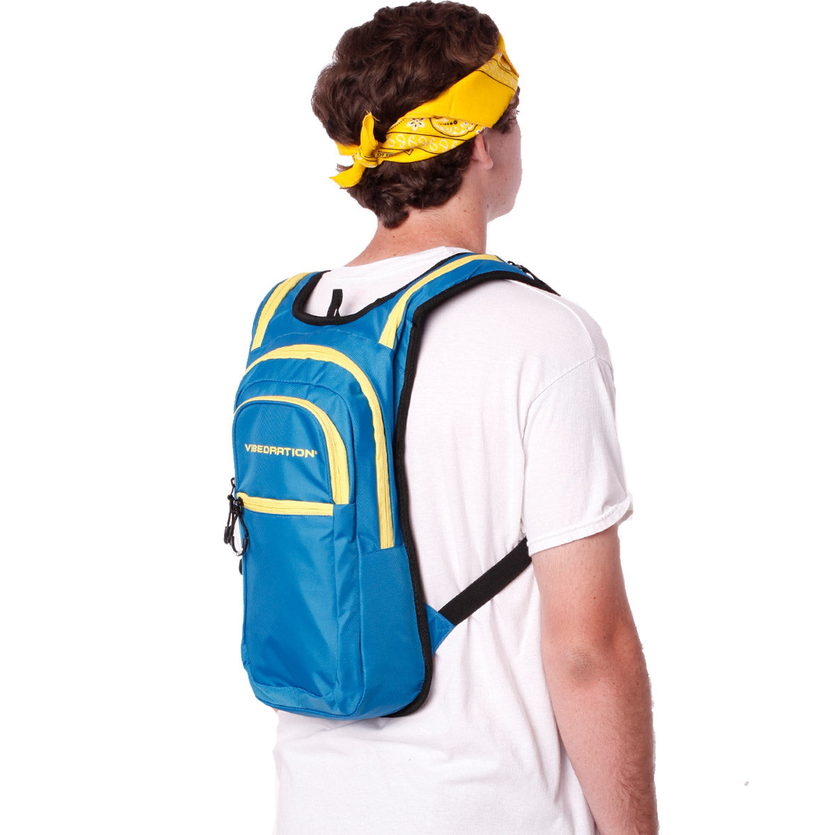 Side view of male wearing baby blue and yellow hydration pack with three pockets.
