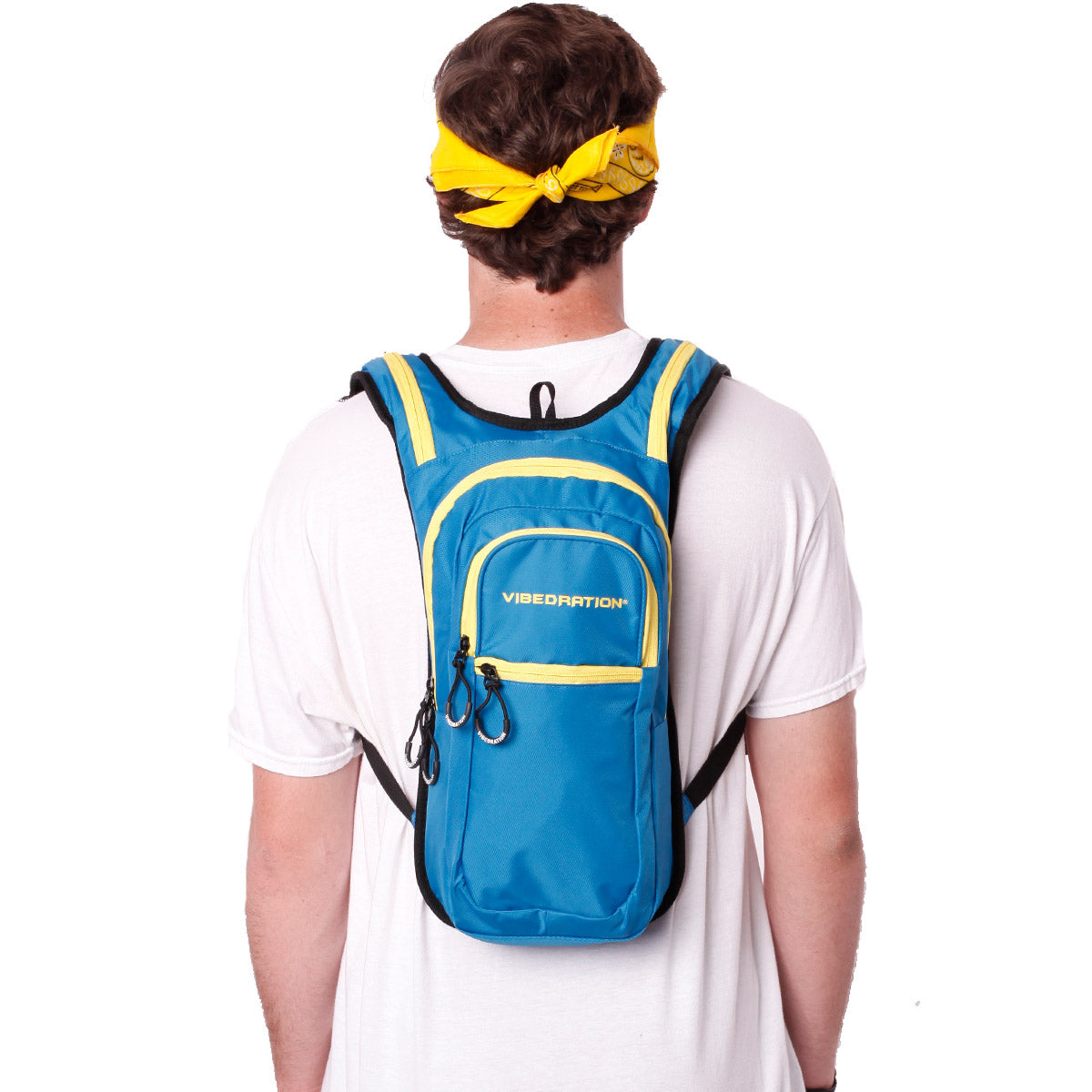 Back view of male wearing baby blue and yellow hydration pack with three pockets.