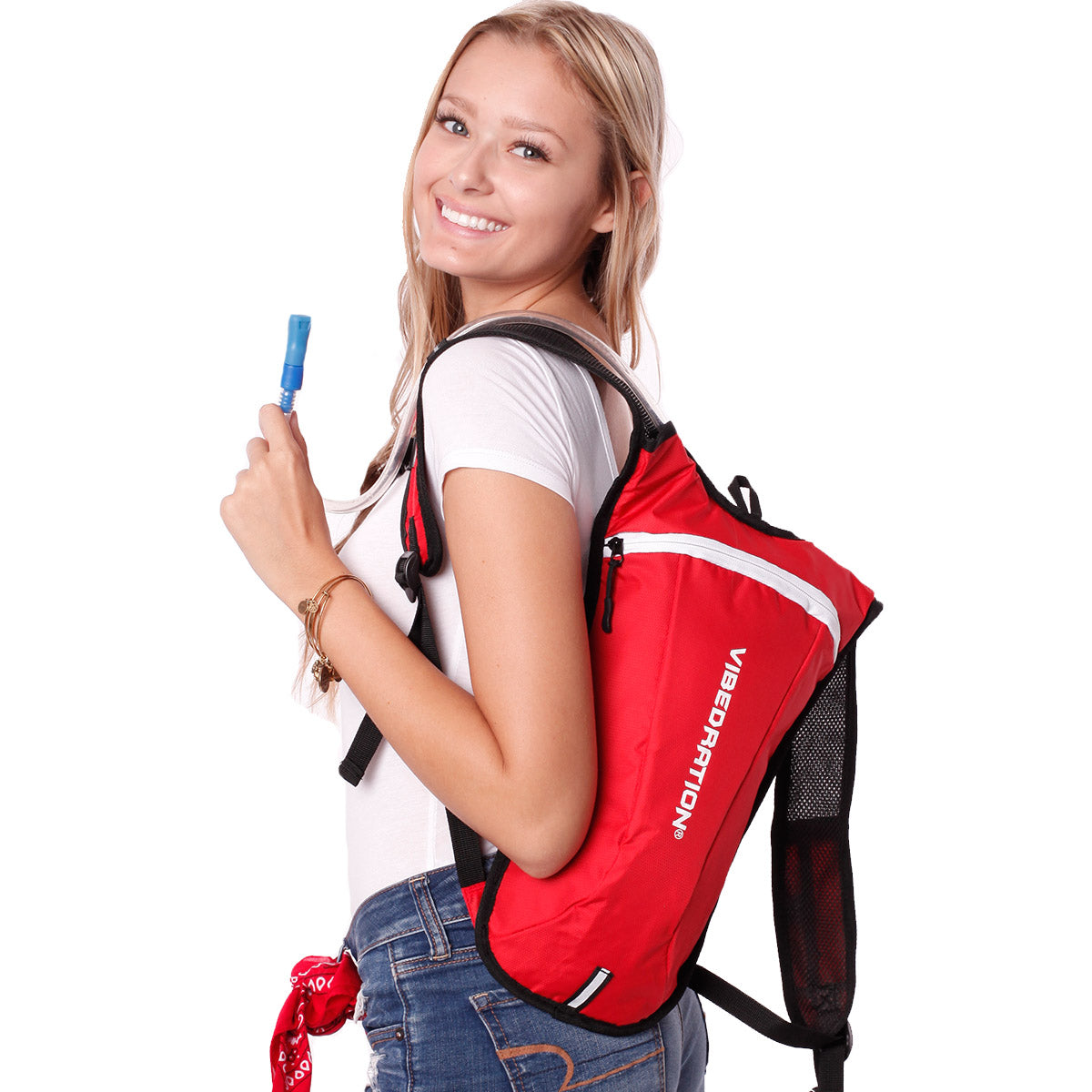 Side view of female wearing red and white hydration pack.