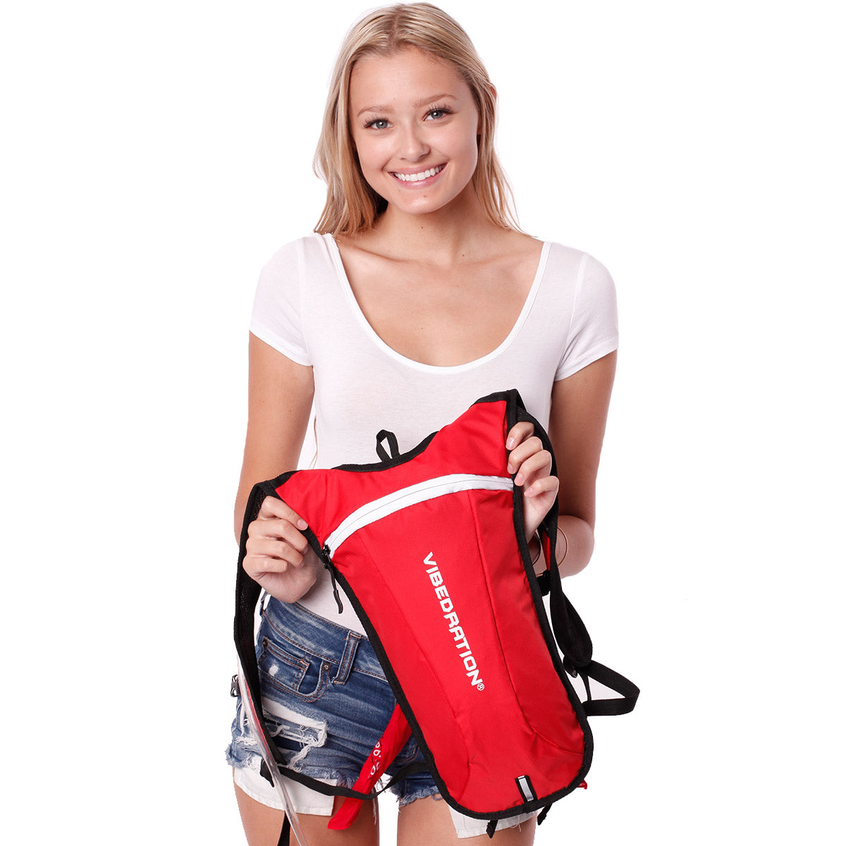 Female holding red and white hydration pack.