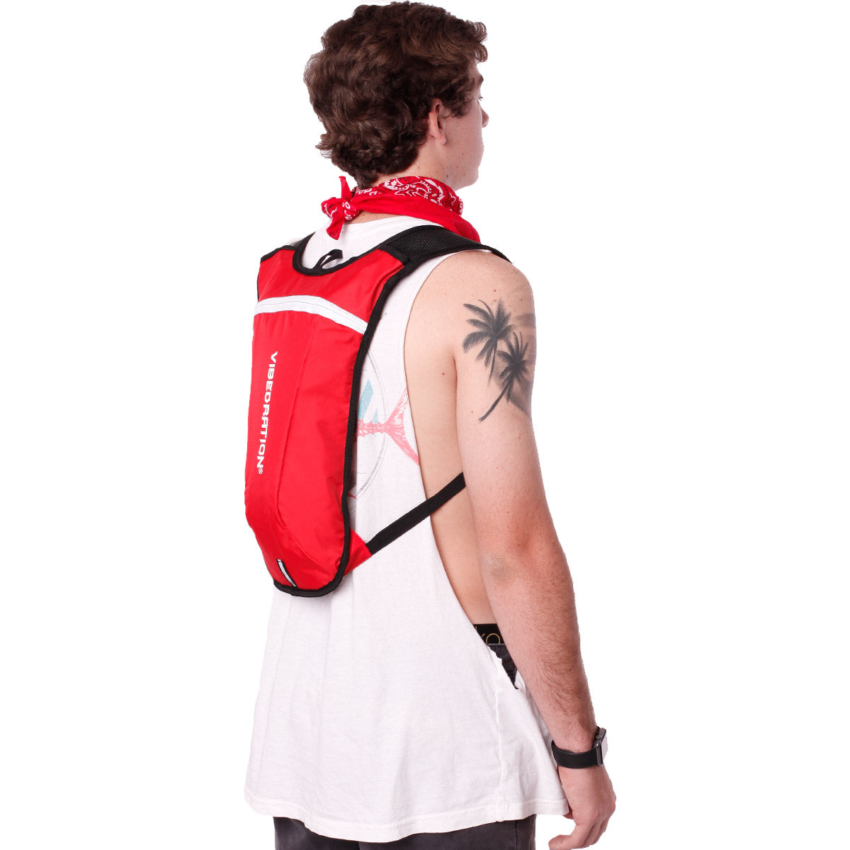 Side view of male wearing red and white hydration pack.