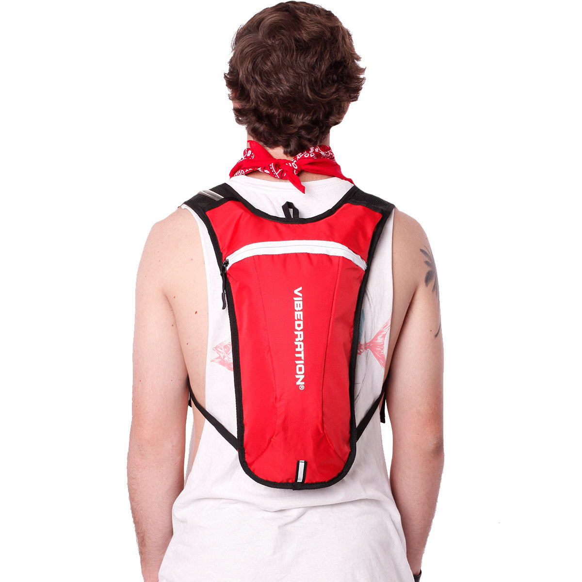 Back view of male wearing red and white hydration pack.
