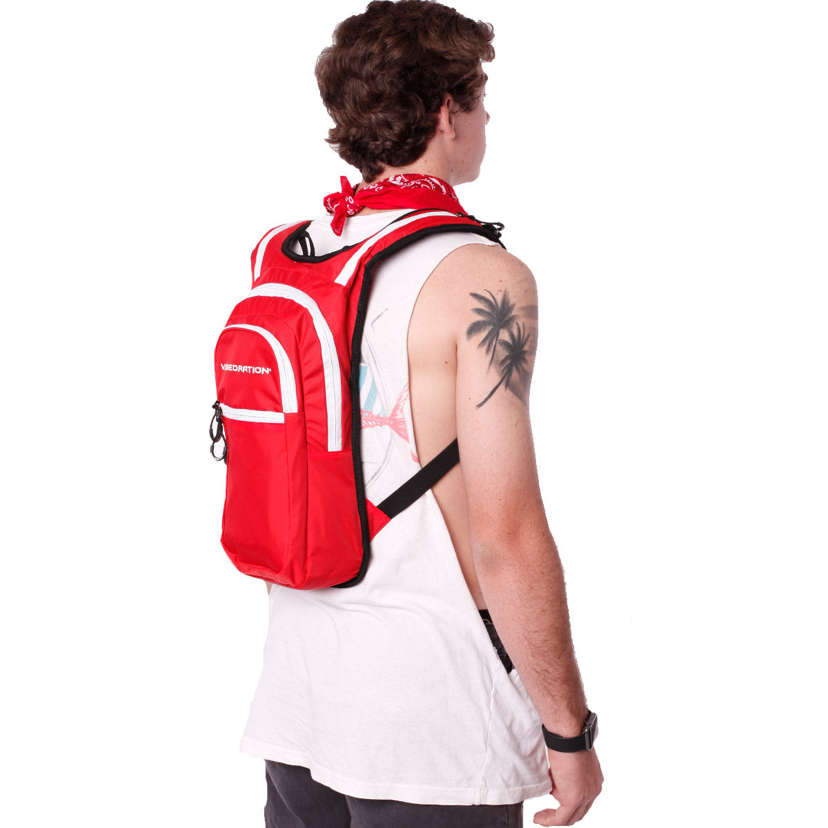 Side view of male wearing red and white hydration pack with three pockets.