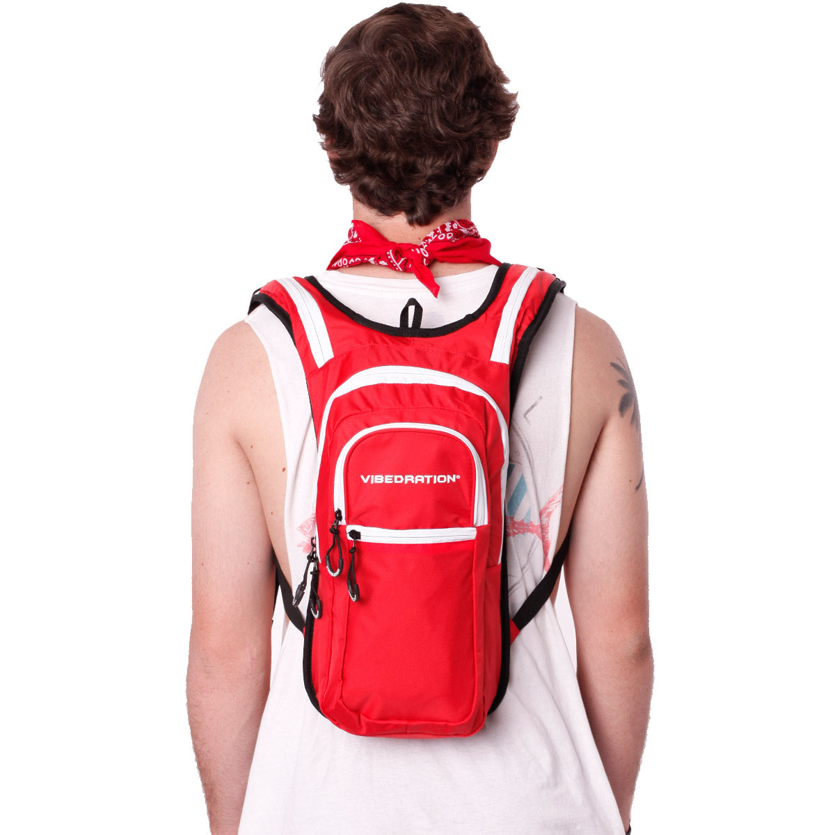 Back view of male wearing red and white hydration pack with three pockets.