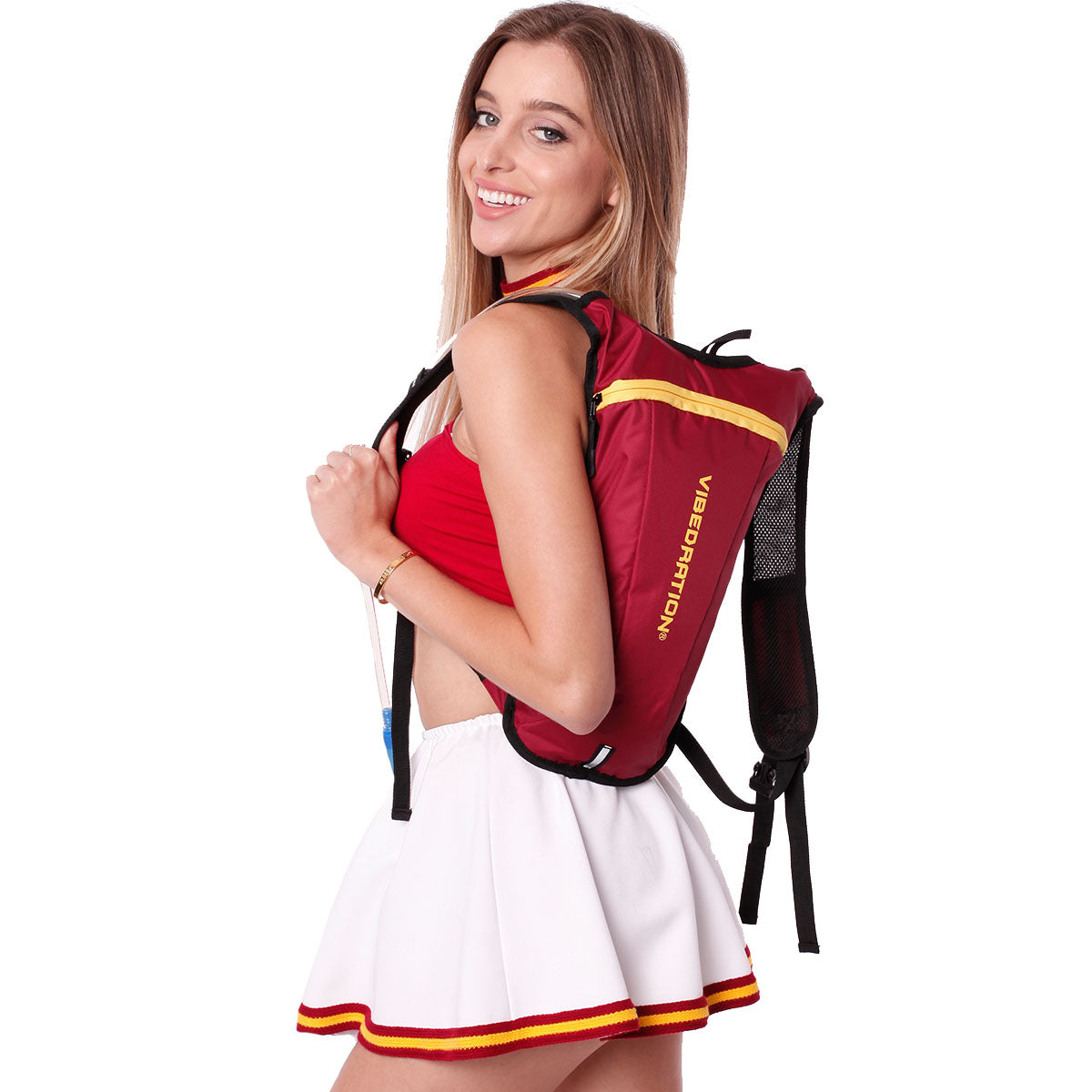 Side view of female wearing maroon and gold hydration pack.