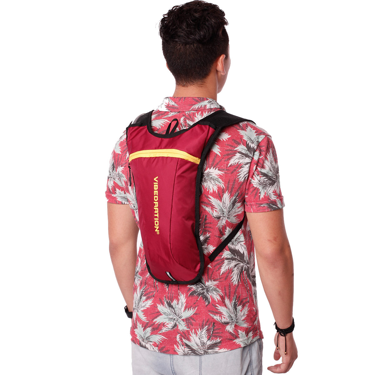 Side view of male wearing maroon and gold hydration pack.