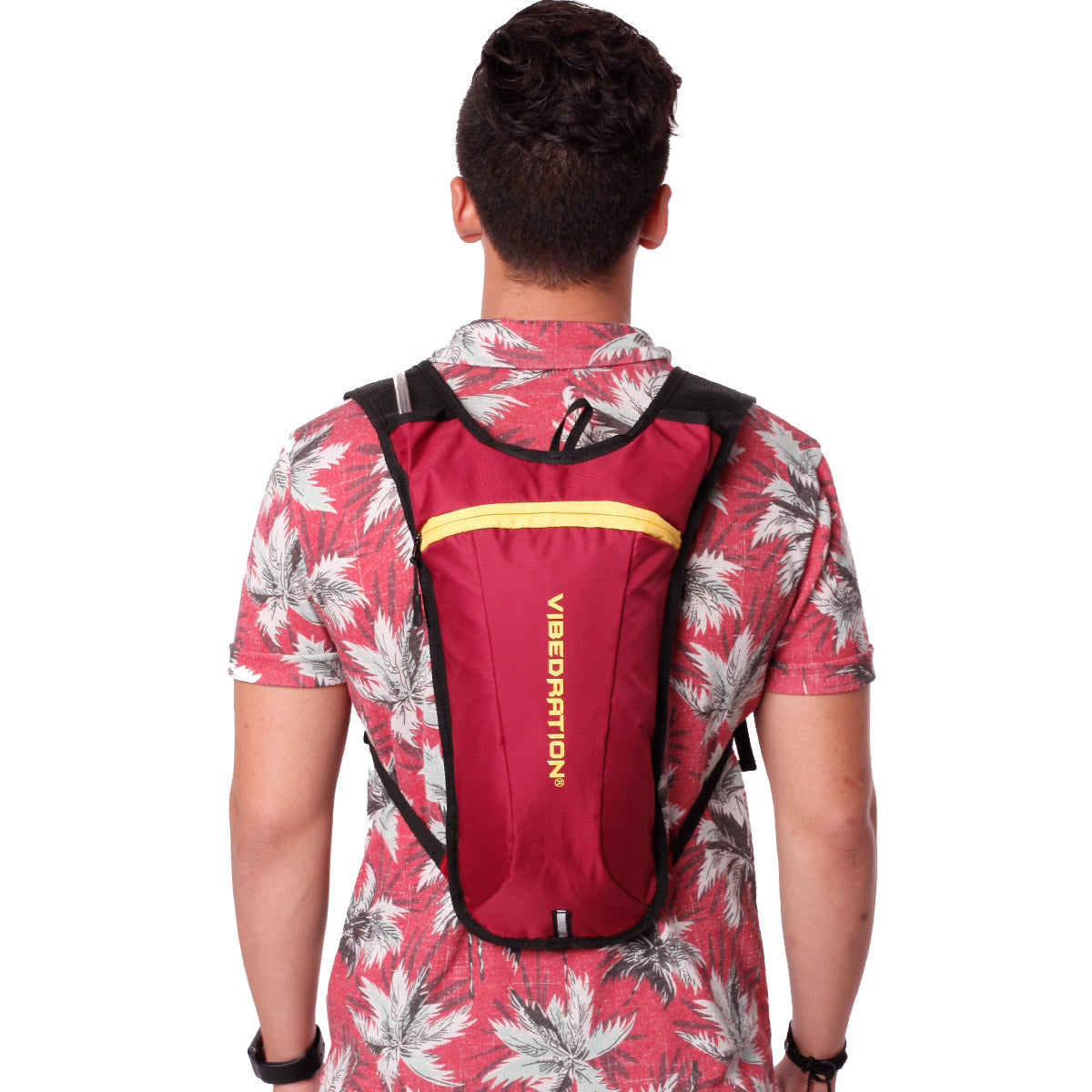 Back view of male wearing maroon and gold hydration pack.