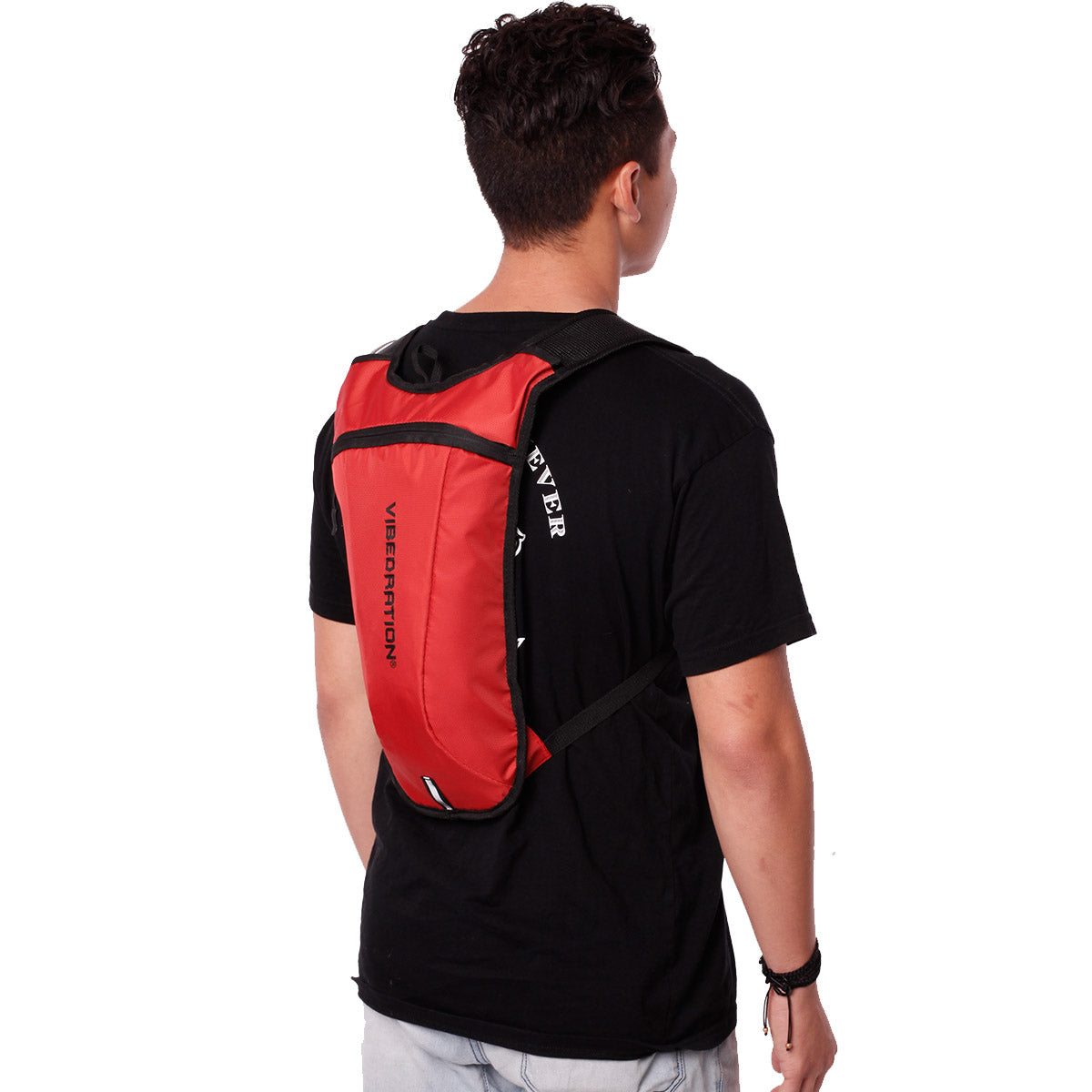Side view of male wearing dark orange hydration backpack.