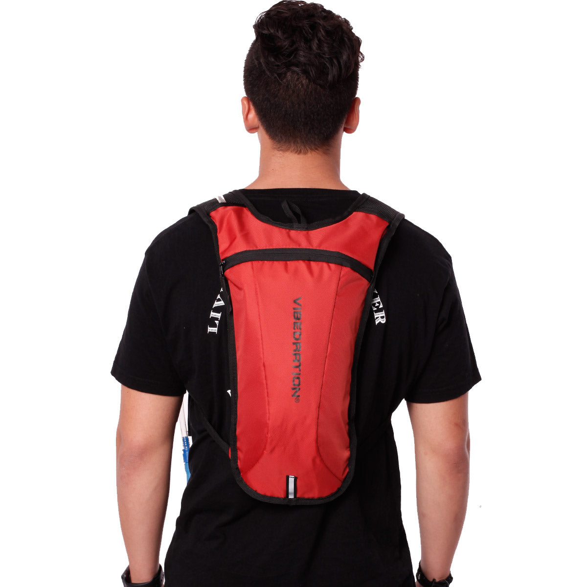 Back view of male wearing dark orange hydration backpack.