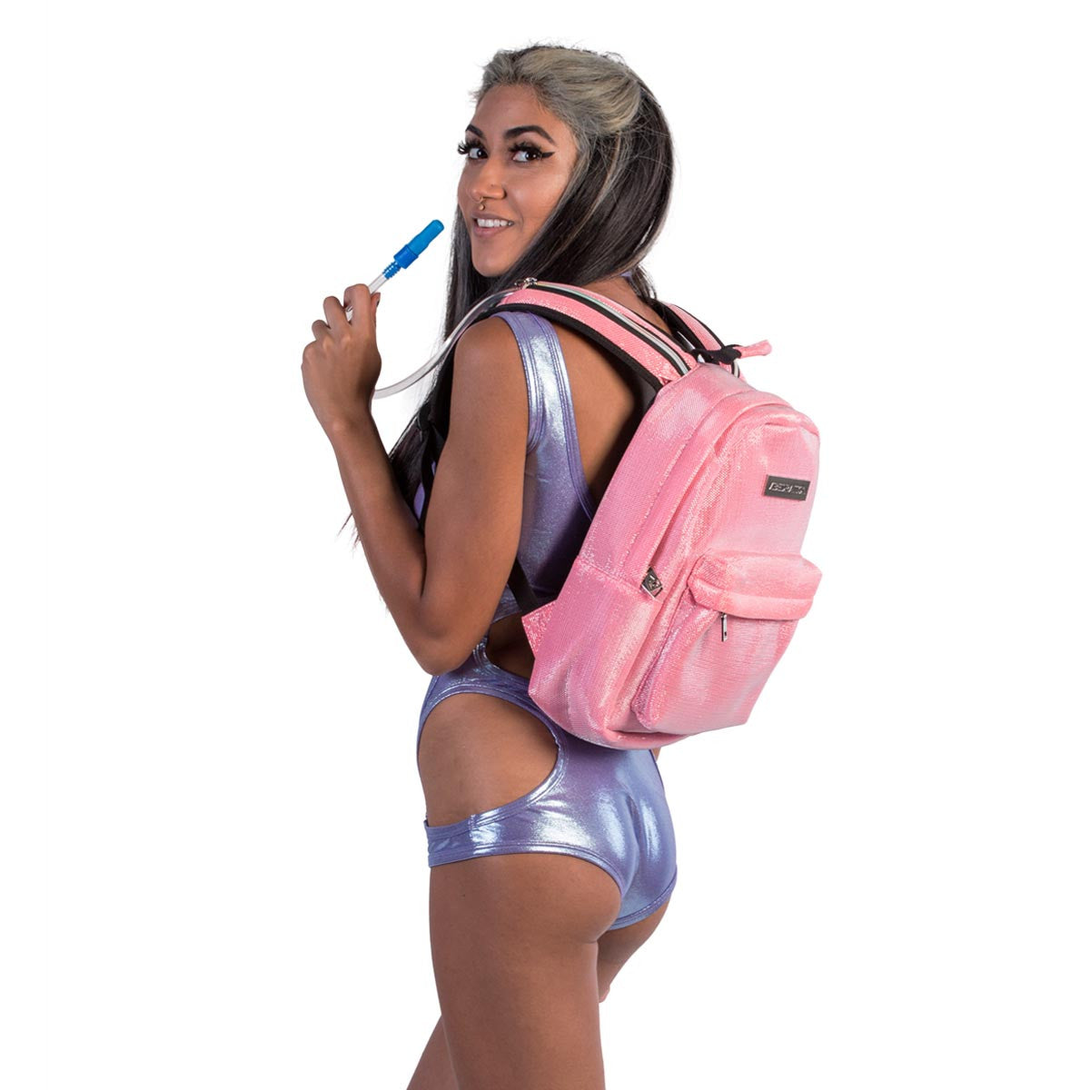 Female wearing Kotton Kandi pink glitter water backpack.