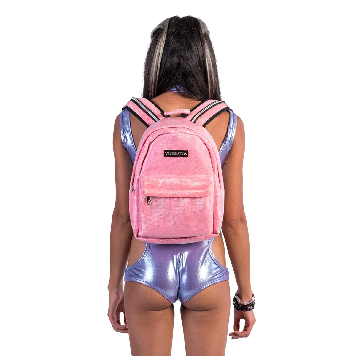 Back view of female wearing Kotton Kandi pink glitter water backpack.