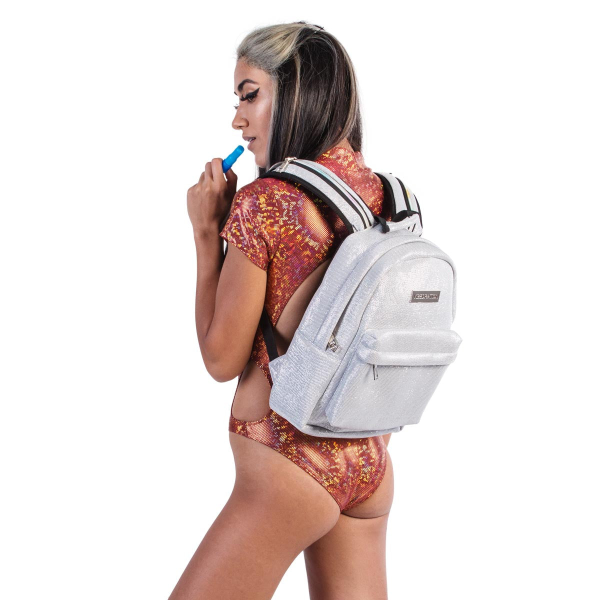 Female wearing titanium silver glitter water backpack.