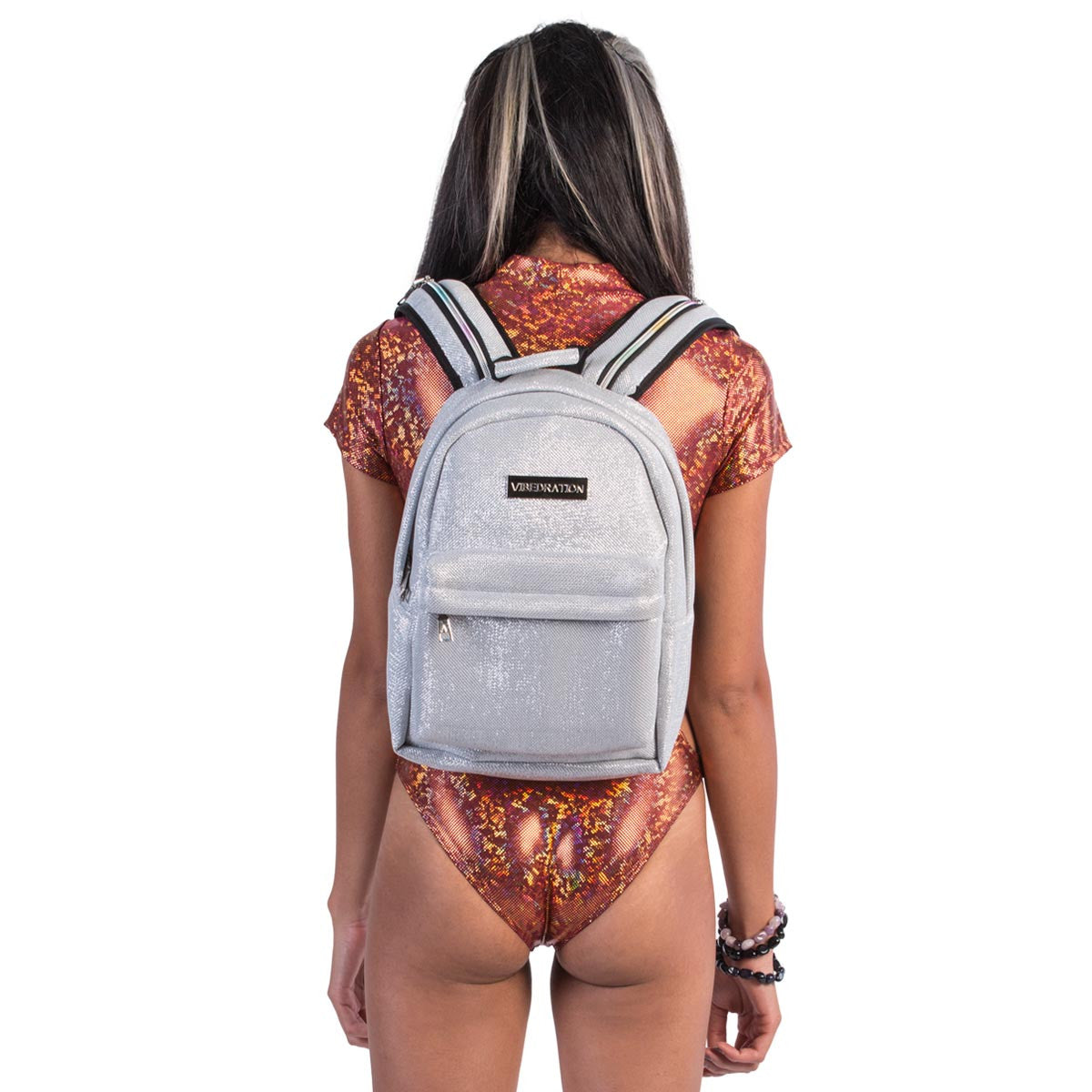 Back view of female wearing titanium silver glitter water backpack.